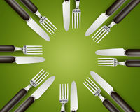Empty copy space circle in set of knives and forks. On green background Stock Photo