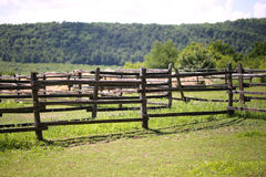 Empty corral without animals rural scene. Closeup of wooden fence on a corral farmland rural scene Royalty Free Stock Image
