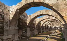 Empty corridor with arcs and blue sky. Ruins of Smyrna Stock Images