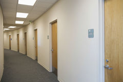 Empty Corridor With Closed Doors Stock Photos