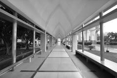 Empty corridor between garden and building Royalty Free Stock Photography