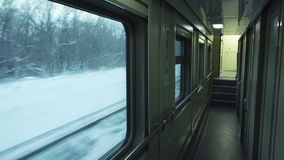 Empty corridor of moving passenger train car.