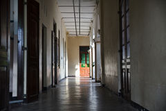 Empty corridor in old building. With doors long it royalty free stock image