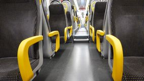 Empty corridor and seats in modern train. Wagon. Black and yellow colored stock video
