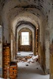 Empty corridors of an abandoned prison building of the late 19th century. In Borovsk, Russia stock photography