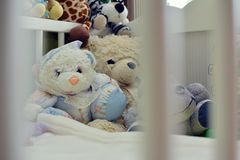 Empty cot with toys Royalty Free Stock Photography