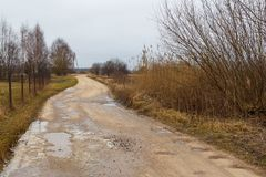 Empty country, field road in winter. Latvian. Village Stock Photo