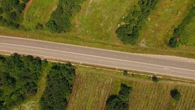 Empty Country Highway Between Fields With Greenery stock footage