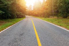 Free Empty Country Road At Sunset Stock Image - 101022001