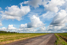 Empty country road perspective with dramatic cloudy sky Stock Image