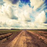 Empty country road perspective with dramatic cloudy sky Stock Photo