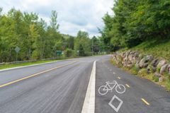 Road with reserved bicycle lane royalty free stock images