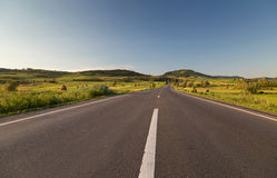 Empty country road, in Sibiu county, Transylvania. Romania Stock Image