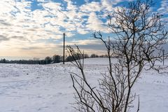 Empty Countryside Landscape in Sunny Winter Day with Snow Covering the Ground with Power Lines in Frame, Abstract Background with. Deep Look - Concept of Fun royalty free stock photography