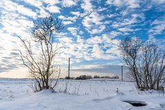 Empty Countryside Landscape in Sunny Winter Day with Snow Covering the Ground with Power Lines in Frame, Abstract Background with. Deep Look - Concept of Fun stock image