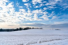 Empty Countryside Landscape in Sunny Winter Day with Snow Covering the Ground with Power Lines in Frame, Abstract Background with. Deep Look - Concept of Fun stock photography