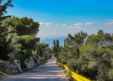 Empty countryside road with Hymettus mountain background, Athens stock photo
