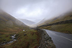 Empty countryside road raining. Empty countryside road in at lake district with rain, UK Stock Image