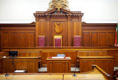 Free Empty Courtroom, With Old Wooden Paneling Royalty Free Stock Photography - 125426997
