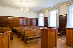Empty courtroom with wooden benches Stock Photos