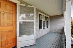 Empty covered porch with double front door. House exterior stock photography