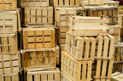 Empty crates. Pile of empty wooden crates waiting for transportation Stock Photo