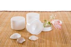 Empty cream jars on bamboo mat Stock Photos