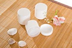 Empty cream jars on bamboo mat Royalty Free Stock Image