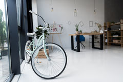 Empty creative office with bicycle and workspace at daytime. Interior of empty creative office with bicycle and workspace at daytime Stock Photo