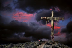 Empty Cross Against an Angry Sky Royalty Free Stock Photos
