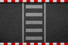 Empty crosswalk on asphalt road with red and white sign on sidew Royalty Free Stock Photo