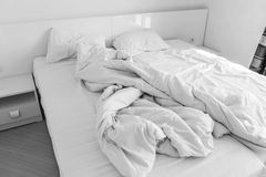 Empty crumpled bed Royalty Free Stock Photos
