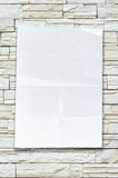 Empty crumpled paper on stone wall Stock Images