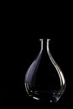 Empty crystal decanter on black background Royalty Free Stock Image