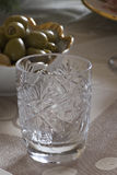 Empty crystal shot glass on a table Stock Image