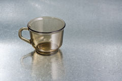 Empty cup. On silver background Stock Photo
