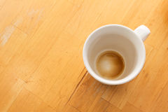 Empty Cup. An empty cup of coffee viewed from above on a wooden table Stock Photography
