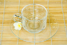 Empty cup on the bamboo wrap Royalty Free Stock Images
