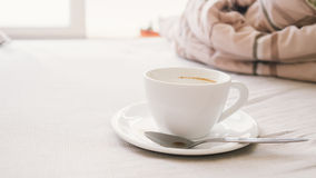 Empty cup on bed. royalty free stock image