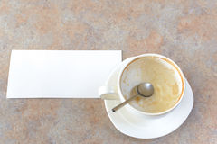 Empty cup of capuccino at cafe Stock Photos