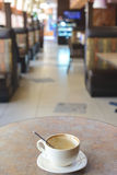 Empty cup of capuccino at cafe Stock Photography