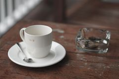 Empty cup of coffee and ashtray. stock photos
