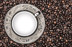 Empty cup of coffee and coffee beans Stock Photos