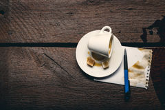 Empty cup of coffee. Cup of espresso poured out on the table Royalty Free Stock Photos