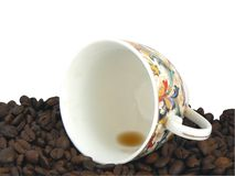 Empty cup and coffee grain Royalty Free Stock Image