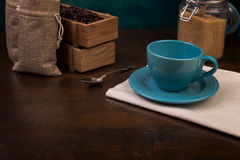 Empty cup of coffee and jute bags Stock Photo