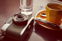 Empty cup of coffee and retro camera royalty free stock photo