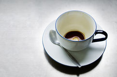 Empty Cup of Coffee with spoon Royalty Free Stock Images