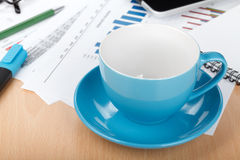 Empty cup on contemporary workplace Royalty Free Stock Images