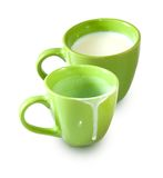 Empty cup and a cup of milk Stock Photo